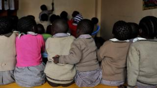 Pupils, some of them orphans sit during a lesson at a Nyanyo Project's preschool in Kibera, one of Africa's largest slums on 29 November 2010