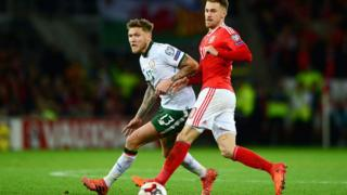 Jeff Hendrick of the Republic of Ireland and Aaron Ramsey of Wales battle for possession