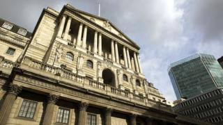 Bank of England building with clouds above