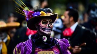 "People fancy dressed as ""Catrina"" take part in the ""Catrinas Parade"" along Reforma Avenue, in Mexico City on October 22, 2017"