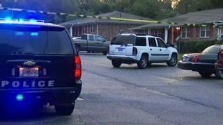 Police attend scene of girls' death