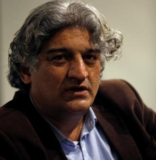 Matiullah Jan, a journalist and columnist, reacts during an interview with Reuters at his office in Islamabad, Pakistan March 13, 2019.