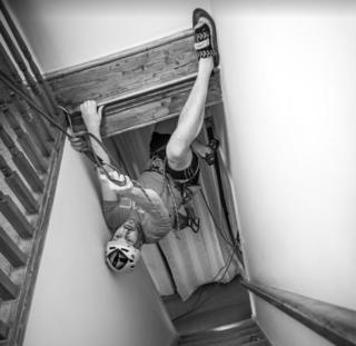 Man climbs in stairwell