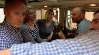 Members of Australian Channel Nine TV crew and Sally Faulkner (centre) sit inside a minivan after their release on bail in Lebanon (20 April 2016)