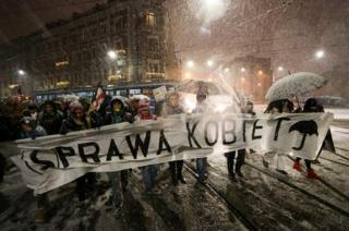 """People gather to protest against plans to further restrict abortion laws in Krakow, Poland January 17, 2018. Jakub Porzycki/Agencja Gazeta via Reuters Banner reads """"Women""""s rights - women""""s business"""" ."""