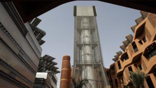 Wind tower and PV panels, Abu Dhabi (Image: AP)