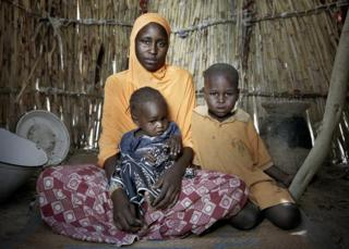 chelou Bossomi, 20, with her 18-month-old daughter Khalfoumi, and son Abba, 4, IDP camp on the outskirts of Mémé
