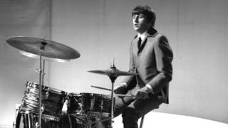 Ringo Starr at the drum kit during his days in The Beatles