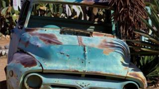 rusting old car
