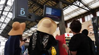 Passengers look at information screen at Saint-Charles railway station in Marseille, south-eastern France, on May 31, 2016