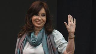 Cristina Fernandez de Kirchner waves to supporters