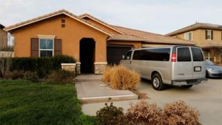 A van sits parked on the driveway of the home of David Allen Turpin and Louise Ann Turpin in Perris, California.