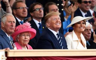 Prince Charles, the Queen and Mr and Mrs Trump look upward