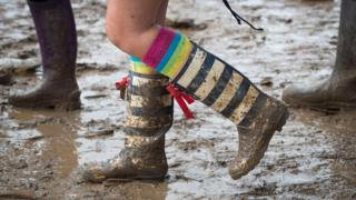 A muddy punter at Glastonbury