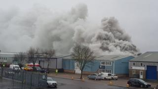 Plumes of smoke rising from industrial unit at Rackheath