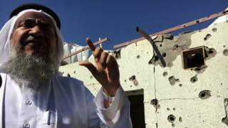 Saudi villager showing the BBC damage from a rocket attack from rebels in Yemen the day before