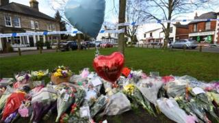 Floral tributes outside the pub