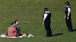 Police speak to couple in London park