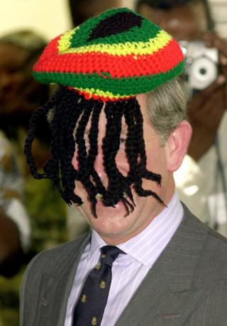 Prince of Wales laughing with the local Rasta community at the Trenchtown community centre in Kingston, Jamaica