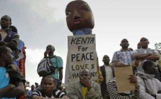 A puppeteer (C) holds a placard with message of peace during a peace prayer rally organized by different religious leaders in Nairobi, Kenya, 7 July 2017.