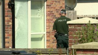 Windows were damaged when several shots were fired at the Lisburn flat