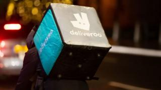 Deliveroo rider at night
