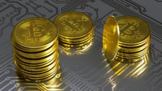 Gold bitcoins on circuit board graphic