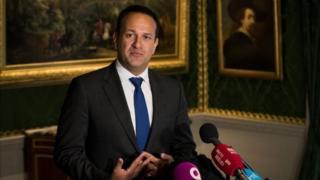 Irish Prime Minister Leo Varadkar speaks to the press inside Hillsborough Castle.