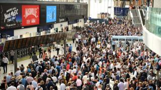 Crowd of commuters at Waterloo Station in London