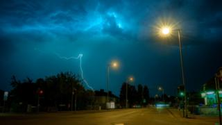A lightning bolt and bright blue sky in Cambridge
