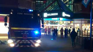 Fire engine outside of shopping centre