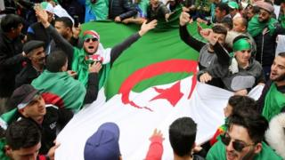 People carry Algeria's national flag in Algiers. File photo