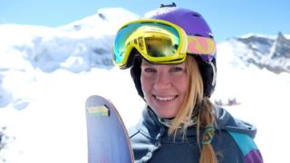 Charlie with her snowboard