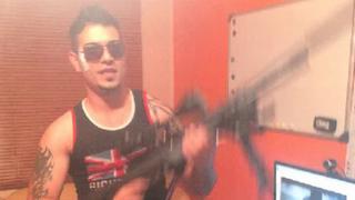 Ashkan Ebrahimi holding a gun