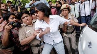 A protester is arrested by police outside of India's supreme court