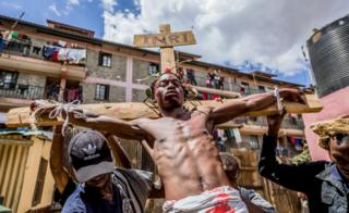 in_pictures Christian devotees re-enact the Way of the Cross, or Jesus Christ's passion, during a Good Friday commemoration in the Kibera slum of Nairobi, Kenya - 19 April 2019