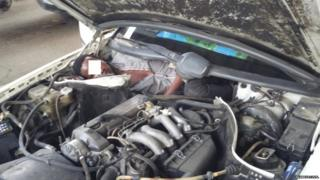 Migrant hiding next to car engine, Guardia Civil photo
