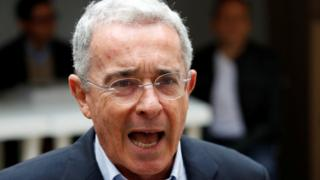 "Colombia""s former president Alvaro Uribe Velez speaks to the news media after casting his vote"