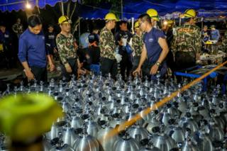 Scuba tanks are delivered to the rescue operation site for the Thai navy