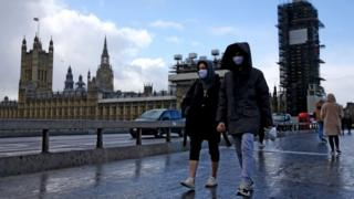 Technology People with facemasks outside Parliament in Westminster