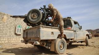 Armed Yemeni tribesman loyal to President Abdrabbuh Mansour Hadi aims a machine-gun in the Sirwah area on 7 December 2015