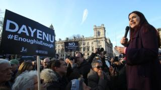 Luciana Berger talking to protesters in London
