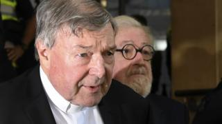 Cardinal George Pell and his lawyer Robert Richter leaving a Melbourne court on Tuesday