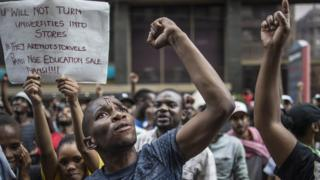 Students shout slogans outside the African National Congress ruling party (ANC) headquarters, on 22 October 2015, in Johannesburg, South Africa, during a demonstration against university fee hikes