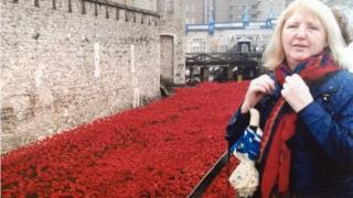 Myra Curtis visiting the remembrance installation in London