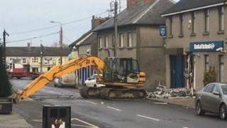 A digger on Main Street in Dunleer