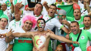 Algerian football fans watching a match