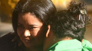 Maira Figueroa is embraced by a relative, shortly after being released from the Women's Rehabilitation centre in Ilopango, El Salvador on March 13, 2018