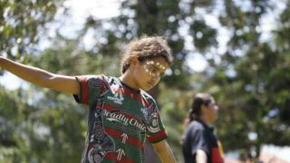 A kid performs a traditional dance at Musgrave Park during the rally. Indigenous Yuggera and Turrbal people organised a rally known as Meanjin on a date synonymous with the beginning of British colonial rule and oppression of Aboriginal people.