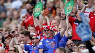 Salford Red Devil fans celebrate during the Dacia Magic Weekend match at St James' Park